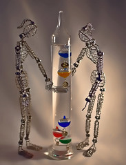 Galileo Thermometer (Jo-Cooler Than Usual Summer...Yay!!!!!) Tags: water glass strange metal colours different floating statues science inside unusual thermometer lightbox coils galileo innerworkings odc duriosity flickrfriday facinated amazoneve amazonanne