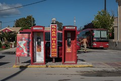Better Let ET Know (Number Johnny 5) Tags: street shadow red signs bus outdoors nikon candid telephone greece d750 tamron corfu phonebox sidari 2016 2470mm