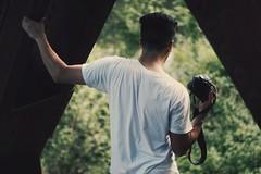Get a Grip (rachelleclair) Tags: green bokeh guy male man vscocam photography 20under20 white camera hand holding strap wrist bridge under