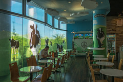 alone (mohamedyamin_masop) Tags: olympus pent street people ice cream restaurant shopping mall cows mural