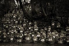 Procession of Small Gods (Seeing Visions) Tags: park trees monochrome japan sepia kyoto jp granite weathered 2009 kiyomizudera sculptures jizo bibs eroded purewater raymondfujioka