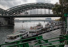 Sightseeing Ships docked along the River Rhine in Cologne (PhotosToArtByMike) Tags: hohenzollernbridge rhineriver colognegermany sightseeing ship cologne germany dom koln rail railway klnerdom oldtown oldquarterofcologne europe