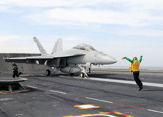 A sailor signals an F/A-18F Super Hornet. (Official U.S. Navy Imagery) Tags: heritage america liberty freedom commerce unitedstates military navy sailors fast pacificocean worldwide tradition usnavy protect deployed flexible onwatch beready defendfreedom warfighters nmcs chinfo sealanes warfighting preservepeace deteraggression operateforward warfightingfirst navymediacontentservice