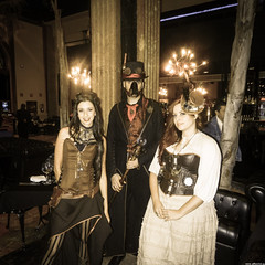 Going SteamPunk (JF Sebastian) Tags: barcelona portrait hat cane sepia hall costume dress mask group goggles corset cafeteria steampunk morethan100visits morethan250visits nikoncoolpixs9100 eurosteamcon2012