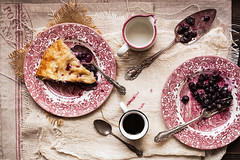 Blueberry Pie on Plates (onegirlinthekitchen) Tags: china wood stilllife cup coffee canon vintage crust table dessert 50mm baking milk berries dish sweet plate fork spoon cotton butter american espresso cloth pitcher chiaroscuro flaky spatula teaspoon blueberrypie foodphotography