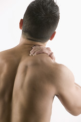 Back Pain. Photo Credit: http://office.microsoft.com/ (EASTCOBBERMagazine) Tags: people men muscles photography 1 back pain barechested bare colorphotography relief males shoulder adults touching rubbing backview headandshoulders irritation hispanics partiallynude