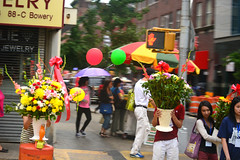 Float (Luis_maldonado) Tags: street flowers light summer people food woman blur color slr colors girl digital corner umbrella walking asian person store nikon pattern cross walk space crowd balloon cement run block bouquet cart dslr float carry nikond5200