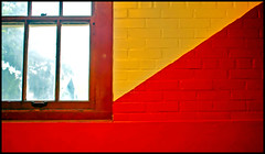 Yellow & Red Triangles (See El Photo) Tags: school red color colour window glass yellow wall oregon digital canon eos rebel triangle colorful colore or bricks indoors frame inside windowpane couleur primarycolor redish yellowish t1i