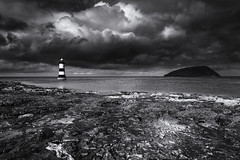 Penmon Lighthouse (Vemsteroo) Tags: travel sea blackandwhite cloud lighthouse seascape beach monochrome weather wales rural canon landscape coast countryside awesome dramatic adventure 5d drama f4 blackpoint untamed 24105 anglesey northwales mkiii mk3 penmon vision:mountain=0522
