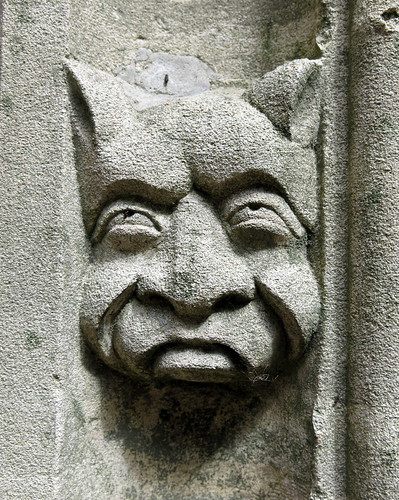 A face in the 15th C. south porch arch, the Church of St Mary, Wilby, Suffolk, England