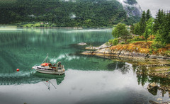 Emerald Reflection of a Fjord Cliff, Norway (Simon__X) Tags: travel blue vacation sky panorama sun mountain holiday seascape tree simon love nature beauty sunshine clouds sunrise landscape island 1 coast boat interestingness interesting rocks aqua flickr heart wave romance explore mostinteresting lush emerald