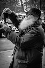 Santa holding his phone upside down (Speedy349) Tags: london seeing sight