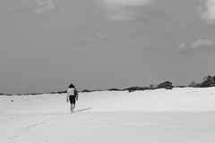Small Human vs. Beach 1 (monique.timlick) Tags: sky blackandwhite bw beach nature beauty clouds canon person ecuador sand open small negativespace figure tropical footsteps galapagosislands smallfigure