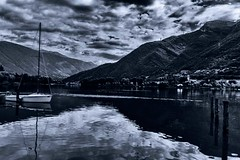 Riflessi sul lago (u.giommetti) Tags: blackandwhite italy lake reflection clouds lago boat europa europe barca italia nuvole riflessi montagna lombardia montain biancoenero