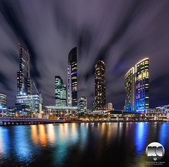 Fleeting clouds above the city (kenneth chin) Tags: city architecture clouds yahoo google nikon australia melbourne victoria southbank crown nikkor eurekatower verticalpanorama yarrariver digitalblending d810 1424f28g