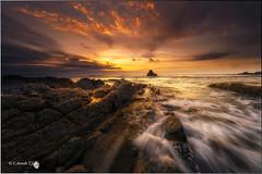 Oro (Caramad) Tags: light sunset sea espaa seascape color sol marina landscape mar agua rocks playa puestadesol olas rocas sopelana atxabiribil marcantbrico camadats