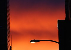 City Sunset (ikan1711) Tags: windows sunset red lamp buildings reflections sunsets lamps redsky vancouverbc sunsetclouds lampposts redclouds windowreflections sunsetskies redsunsets allclouds allsunsets sunsetoutlines