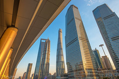 Pudong Lineup (Andy Brandl (PhotonMix.com)) Tags: china urban nikon skyscrapers shanghai pudong modernarchitecture linedup inarow orientalpearltower goldenlight swfc shanghaitower photonmix financialdistrictshanghai