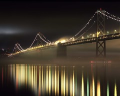 Fog and the Other Bridge (RZ68) Tags: ocean morning bridge sea sky water fog night reflections dark island dawn lights oakland golden bay coast early gate san long exposure treasure no low towers under calm velvia pre embarcadero yerba provia francsico buena rz67 tule e100