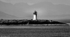 Scotland West Highlands Argyll a little lighthouse on some dangerous rocks 2 miles from the coast 29 May 2016 by Anne MacKay (Anne MacKay images of interest & wonder) Tags: sea blackandwhite lighthouse west monochrome by anne coast scotland highlands argyll may picture mackay 29 2016 xs1