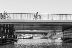 Family time trial (krakeel) Tags: street bridge bw haven bicycle 50mm cycling nikon harbour brug breda fietsen fiets straatfotografie moedermetkind d80 krakeel