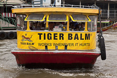 (by claudine) Tags: world sign asian thailand boat travels asia photos bangkok unique culture tourist exotic transportation thai attraction watertaxi customs tigerbalm expat travelphotography boattaxi byclaudine