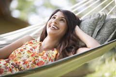 pretty, mid-adult woman gazing up while lying on a hammock (hammockbuddy) Tags: ifttt 500px floral outdoor summer woman pretty happy dress relaxation hammock candid country life stylish leisure laughing one person looking up lying down cottage half length 20s adult rural living daytime midadult east indian ethnicity countrylife lookingup lyingdown oneperson 20sadult halflength midadultwoman cottagelife ruralliving eastindianethnicity calgary alberta canada ca