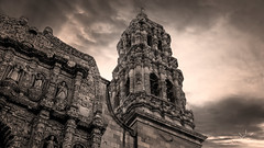 Between Worlds.. (http://sotochristian2.500px.com/) Tags: street sky blackandwhite bw sun storm art church monochrome clouds sunrise mexico cathedral cloudy outdoor catedral iglesia zacatecas drama cloudscape phography wclx100 fujifilmx100t