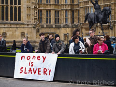 P5045476 (pete riches) Tags: uk london westminster protest parliament flags demonstration banners anonymous barriers slogans placards austerity occupy ringofsteel abingdonstreet spendingcuts peteriches occupylondon wearethe99 moneyisslavery