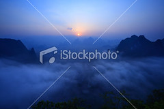 Guilin-hills-in-mist-at-sunrise (MPBHAIBO) Tags: china travel mist mountain horizontal fog forest sunrise river landscape outdoors dawn liriver asia guilin yangshuo hill nobody journey limestone  idyllic cloudscape scenics rockformation mountainrange tranquilscene  vibrantcolor landscaped    xingping famousplace mountainpeak ruralscene  beautyinnature nonurbanscene karstformation  guangxiregion
