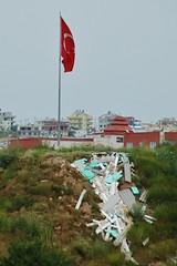 The Turkish flag flying high and proud above a mound of rubbish left over from the building of villas in Altinkum. (LauraEvelynEdwards) Tags: building trash turkey garbage flag urbandecay rubbish development turkish urbanisation rubbishpile