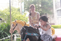 carousel ( aikawake) Tags: baby cute beautiful beauty backlight pretty child sweet carousel littlegirl backlighting warmlight 1y8m