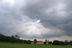 Waiting for the storm (Ali Gardener) Tags: trees house field weather les clouds forest landscape moody farm centre meadow center pole arbres nuages paysage range foret deserted ferme bois dum mraky dvur theblueholeinthesky