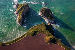 Cornish islets (snowyturner) Tags: sea rocks cornwall waves shadows path trails newquay aerial coastal porth fields mounds islets