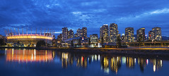Vancouver BC City Skyline with BC Place at Blue Hour (David Gn Photography) Tags: city travel sky panorama canada reflection tourism water station night vancouver clouds lights evening living bc waterfront view dusk stadium britishcolumbia postcard scenic falsecreek bluehour skytrain condominiums bcplace sportsarena creeksidepark
