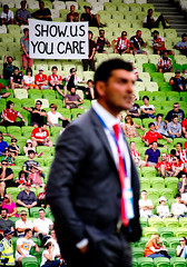 Show Us You Care (vapours) Tags: football coach soccer banner tie australia melbourne victoria suit manager aleague johnaloisi aamipark panasonic100300 olympusem5 vision:people=099 vision:face=099 vision:outdoor=0974