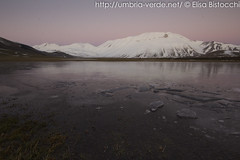 Sunset - Castelluccio di Norcia (Elisa Bistocchi) Tags: park christmas xmas travel winter sunset sky italy lake snow mountains cold ice water frozen amazing europe tramonto neve inverno umbria reflects sibillini vettore castellucciodinorcia