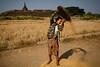 Winnowing rice (Lil [Kristen Elsby]) Tags: travel topf25 topv2222 temple burma editorial myanmar agriculture ricefields rakhine riceharvest travelphotography winnowing mrauku riceharvesting winnow rakhinestate koethaung koethaungtemple myohaung ricefarming mraukoo canon5dmarkii myanmar2013 ricewinnowing