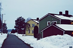 long road with colorful wood houses while winter season (Anamaria Brigitte) Tags: road houses winter snow norway lights colorful long village away late much far