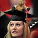 College of Veterinary Medicine student looks around for family during 2014 Commencement.