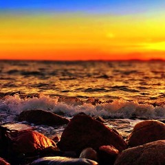"""Dreaming of Summer...."" (maya the viking_girl) Tags: blue sunset red sea sky orange sun beach nature water yellow norway landscape rocks waves ripples tjme skrlevika"
