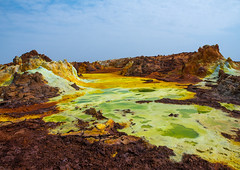 The colorful volcanic landscape of dallol in the danakil depression, Afar region, Dallol, Ethiopia (Eric Lafforgue) Tags: africa travel lake color green tourism nature pool beauty yellow horizontal landscape outdoors volcano spring colorful solitude day desert natural earth acid horizon surreal nobody nopeople formation serenity heat minerals environment sulphur isolation geography geology ethiopia hotspring volcanic saline geothermal interest arid ecosystem hornofafrica afar eastafrica geological abyssinia afarregion dallol danakildepression ethio162009