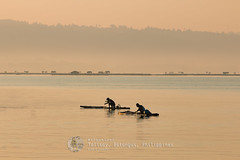 Fishing Buddies - 0524 (webzer) Tags: lake silhouette sunrise fisherman southeastasia outdoor philippines raft batangas fisherfolks webzer talisay taallake akosizer zercabatuan travelzer