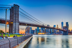 New York City HDR (Photos By RM) Tags: newyorkcity travel bridge sunset tourism skyline brooklyn lights exposure cityscape waterfront skyscrapers outdoor manhattan tourists brooklynbridge promenade bluehour bigapple hdr lowermanhattan multipleexposures brooklynbridgepark freedomtower