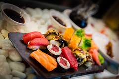 Sushi (King Grecko) Tags: red stilllife food fish green japan dinner canon sushi lunch cuisine raw rice salmon culture pebbles presentation soy slate wasabi tuna teriyaki 2470f28 gastro foodtrends asianjapanese