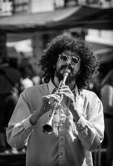 'The Charmer' (Canadapt) Tags: musician man portugal sunglasses hair market lisbon afro feira player clarinet alfama canadapt