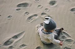 little boy, big world (manyfires) Tags: boy portrait baby film beach hat oregon analog 35mm coast sand child play footprints son nikonf100 pacificnorthwest bandon pnw