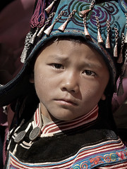 Hilltribe Kid portrait, Yunnan, China (magbrinik) Tags: china travel portraits children tribes yunnan guizhou motherhood kiddies traditionaldress hilltribes nationalgeographic traditionalvillage travelphotography kidsportrait silverjewellery trib kidportrait southestasia tribalportrait childeyes traditionallife ruralportrait portraiturephotography portraitoftheworld travelreportage remoteregion