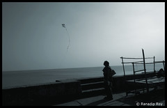 The Kite (RanadipRoy) Tags: kite fly flight steps woman bamboo frame shadows view horizon sunset dusk twilight trip tour travel journey explore beach shore road tourist person nikon d5000 nikond5000 nature landscape outdoor ocean sea bayofbengal westbengal india digha tail