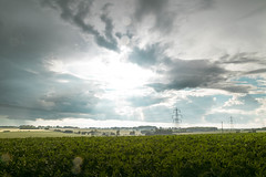 Cloud Chasing (Adam_Marshall) Tags: sunshine adam marshall summer landscape nature sky stereocolours outdoors green sawtry rain field clouds adammarshall timelapse lightning storm weather countryside cambridgeshire canon eos70d sigma 1750mmf28 power lines grey vast empty flat lee filters sun light rays